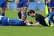 Connor Smith defender for AFC Wimbledon (18) gets a severe injury  during the Sky Bet League 2 match between AFC Wimbledon and Newport County at the Cherry Red Records Stadium, Kingston, England on 7 May 2016. Photo by Stuart Butcher.