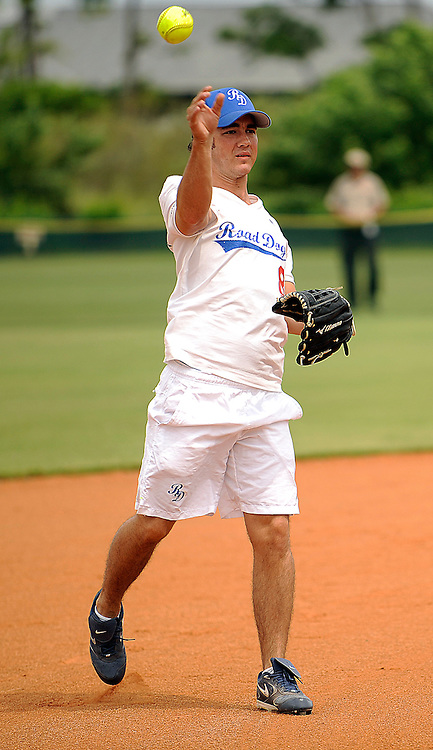 "AUGUST 19, 2009 BOCA RATON FLORIDA- Kevin Jonas, of the Jonas Brothers, throws a ball before the start of their  game against the Marquis Flyers. The Jonas Brothers and their team, the ""Road Dogs"" took part in the softball game which was being held by Marquis Jet at the Saint Andrews School in Boca Raton, Fla. Marquis Jet has held 9 other softball games around the country as their company team the ""Marquis Flyers"" competes in for fun games against various teams. PHOTO BY JOSH RITCHIE"