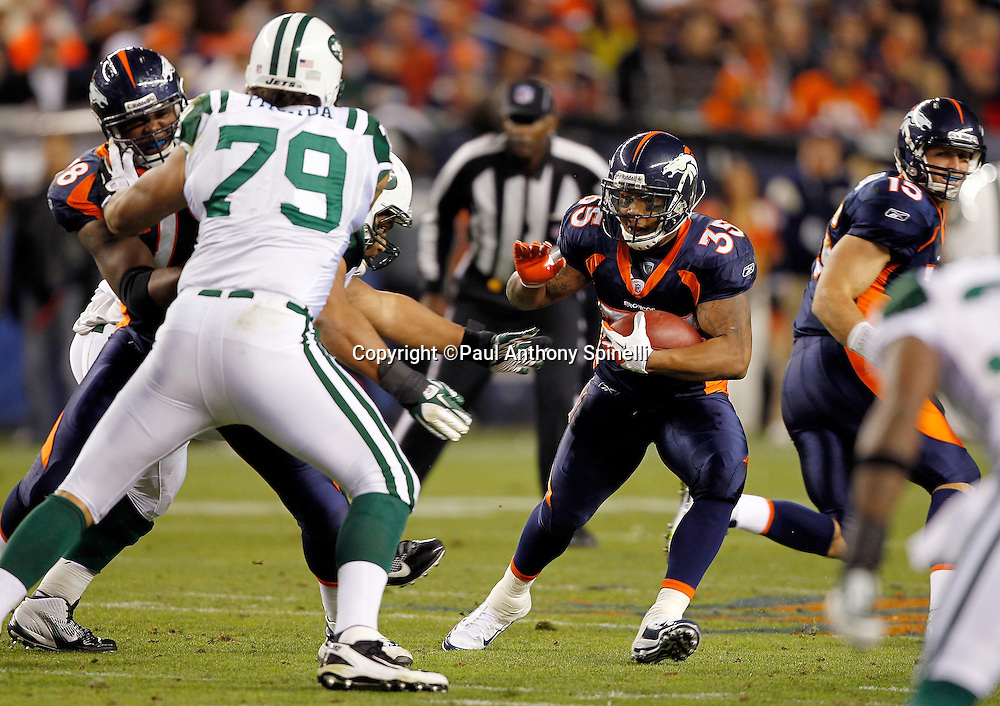 Denver Broncos running back Lance Ball (35) runs the ball up the gut during the NFL week 11 football game against the New York Jets on Thursday, November 17, 2011 in Denver, Colorado. The Broncos won the game 17-13. ©Paul Anthony Spinelli