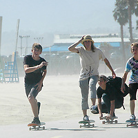 A group of teenager ride their skateboards soulth olong the Santa Monica Bike Path on Wednesday, June 6, 2007.