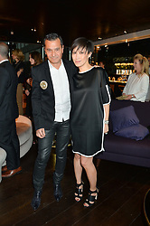 PHILIPPE BENACIN  Co-founder of InterParfums Inc. and SANDRA CHOI Creative Director and designer of J. Choo Limited at the launch of Illicit by Jimmy Choo - a new fragrance faced by Sky Ferreira, held at Mondrian London, 20 Upper Ground, London on 3rd June 2015.