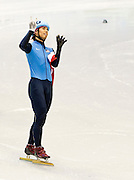 United States short track speed skater Apolo Anton Ohno celebrates his bronze medal in the 1,000 meter race.  This is Ohno's seventh Olympic medal, making him the most decorated US Winter Olympic athlete in history.