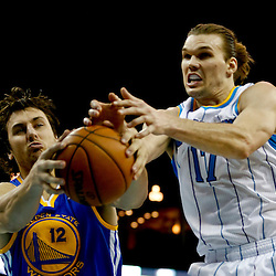 Mar 18, 2013; New Orleans, LA, USA; Golden State Warriors center Andrew Bogut (12) and New Orleans Hornets power forward Lou Amundson (17) battle for possession of the ball during the second quarter a game at the New Orleans Arena Mandatory Credit: Derick E. Hingle-USA TODAY Sports