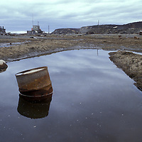 Russia, Barrel floats in polluted river in remote village of Chaibukha in Russian Far East