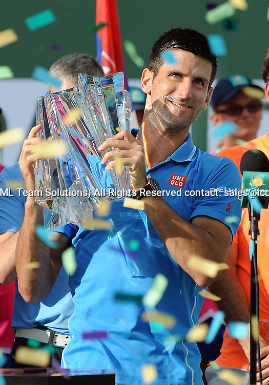 22 Mar. 2015: Novak Djokovic (SRB) holds the winners trophy as confetti falls after Djokovic defeated Roger Federer (SUI) to become a four time champion of the BNP Paribas Open Tennis Tournament played at the Indian Wells Tennis Garden in Indian Wells, CA.