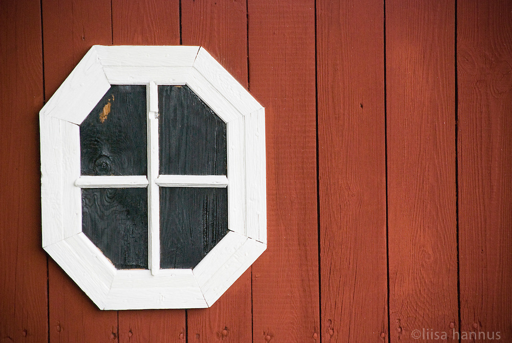 A false window decorates the back wall of an outbuilding on one of the properties near Taxinge Palace, near Stockholm, Sweden.