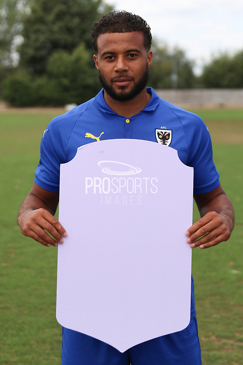 AFC Wimbledon midfielder Tom Soares (19) holding Fifa sign during the AFC Wimbledon 2018/19 official photocall at the Kings Sports Ground, New Malden, United Kingdom on 31 July 2018. Picture by Matthew Redman.
