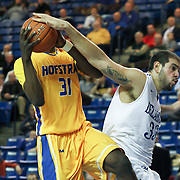 Delaware Forward Carl Baptiste (33) fouls Hofstra Forward Moussa Kone (31) in the second half of a NCAA regular season Colonial Athletic Association conference game between Delaware and Hofstra Wednesday, JAN 8, 2014 at The Bob Carpenter Sports Convocation Center in Newark Delaware.