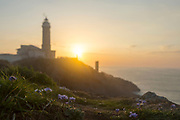 Sunset at Cabo Mayor Lighthouse with spring time flowers, Santander, Spain, Europe.