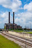 New Orleans, LA, USA -- May 24, 2019.  A vertical photo of an abandoned power plant in New Orleans, LA.