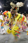 An American Indian dances a Fancy Dance during the Grand Entry at the Denver March Pow Wow in Denver, Colorado March 18, 2005.  More than 1,200 dancers are expected to compete at the event in the tradition of powwows that began hundreds of years ago.  REUTERS/Rick Wilking