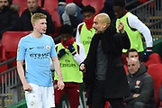 Manchester City manager Pep Guardiola giving instructions to Kevin De Bruyne (17) of Manchester City during the EFL Cup Final match between Arsenal and Manchester City at Wembley Stadium, London, England on 25 February 2018. Picture by Graham Hunt.