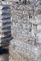 Baled aluminium foil at metal recycling centre waiting to be sold on for remelting and reuse,