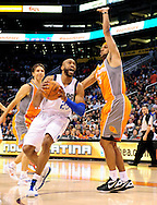Mar. 08, 2012; Phoenix, AZ, USA;  Dallas Mavericks guard Vince Carter (25) drives the ball against the Phoenix Suns forward Jared Dudley (3) during the first half at the US Airways Center.  The Suns defeated the Mavericks 96-94. Mandatory Credit: Jennifer Stewart-US PRESSWIRE.