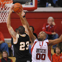 Dec 20, 2008; Piscataway, NJ, USA; Rutgers forward Gregory Echenique (00) jumps to block a shot by Bryant center Nick Pontes during the first half of Rutgers' 67-37 victory at the Louis Brown Rutgers Athletic Center.
