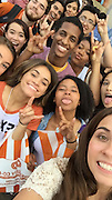 Sharpstown High School senior Corshay Jackson at DYNAMC (Discover Yourself in Accounting Majors and Careers) at UT. Jackson is upper-right student with neon yellow nails.