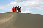 Africa, Tanzania, Maasai tribe an ethnic group of semi-nomadic people a group of tribesmen on a sand dune