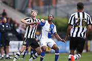 Blackburn Rovers Ryan Nyambe (2)  battles with Notts County forward Jonathan Stead (30)  during the Pre-Season Friendly match between Notts County and Blackburn Rovers at Meadow Lane, Nottingham, England on 31 July 2016. Photo by Simon Davies.