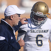 Salesianum Head Coach Bill DiNardo talks with quarterback Garrett Cannon (6) near the sidelines in the fourth quarter during a regular season football game between No. 2 Salesianum and No.1 William Penn Saturday, Oct. 31, 2015 at William Penn High School in New Castle.