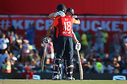 Moeen Ali and Eoin Morgan (Capt) embrace after winning the game during the International T20 match between South Africa and England at Supersport Park, Centurion, South Africa on 16 February 2020.