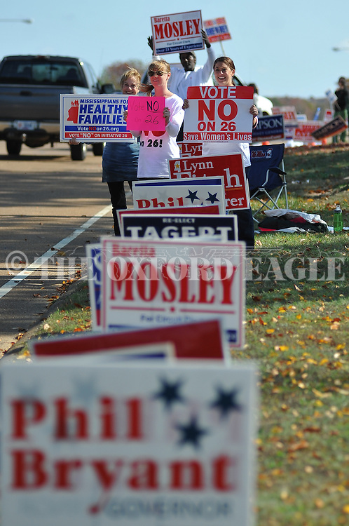 Ann Fisher-Wirth (from l.), Carley Dunavant, and Jill Stevens hold signs against Amendment 26 outside the polls at the Oxford Conference Center in Oxford, Miss. on Tuesday, November 8, 2011. Mississippians go to the polls today for state and local elections, as well as referendums including the so-called Personhood Amendment.