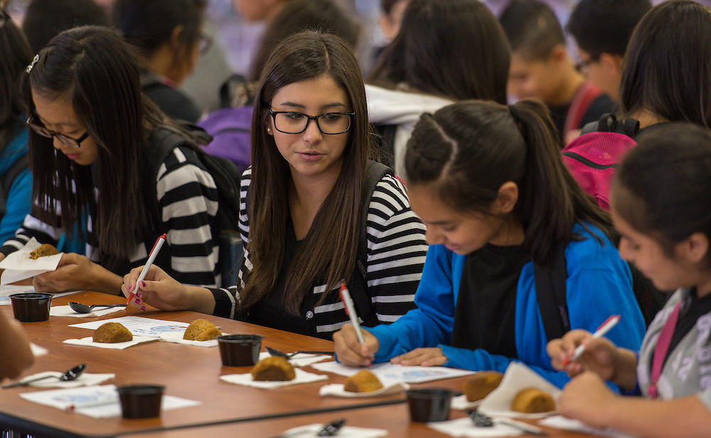 Students participate in a taste test of new food items, including apple muffins, sweet potato muffins and vegetarian chili, prepared by Nutrition Services at Stevenson Middle School, August 29, 2014.