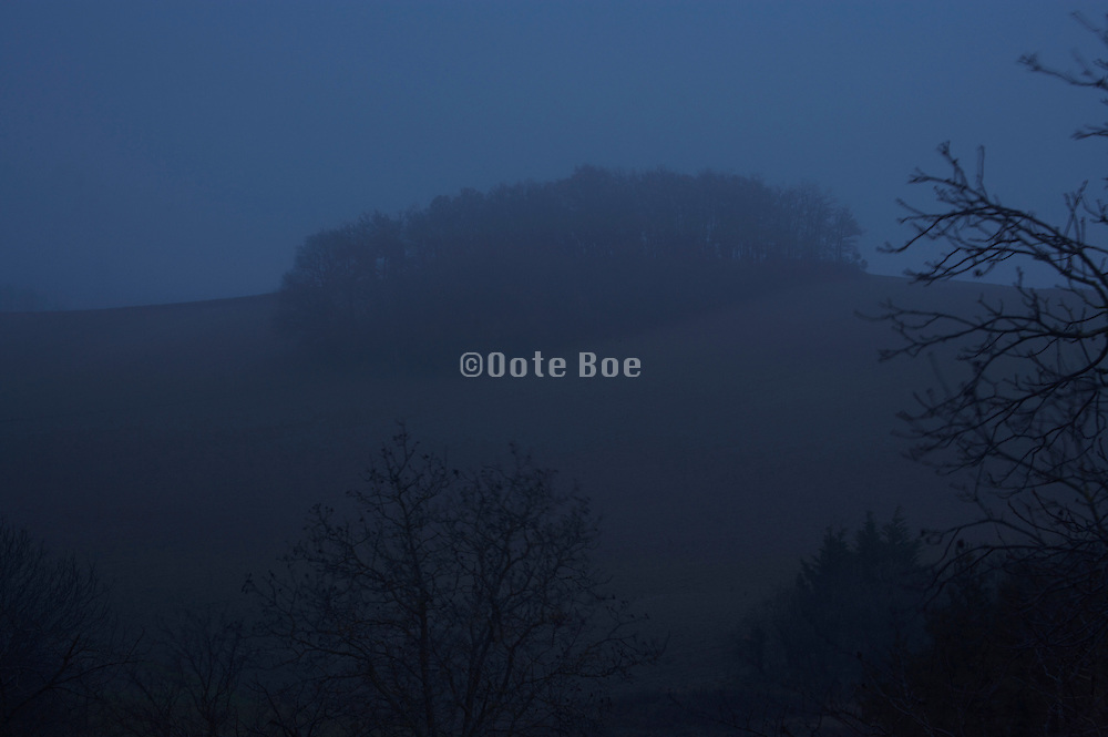 landscape during a very dark day with fog