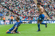 Lyle Taylor of AFC Wimbledon pulls off his shirt after scoring his sides first goal whilst Callum Kennedy of AFC Wimbledon slides on his knees in celebration during the Sky Bet League 2 Play-off Final at Wembley Stadium, London<br /> Picture by Matt Wilkinson/Focus Images Ltd 07814 960751<br /> 30/05/2016