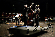 "French bass player Henri Texier storing his instrument after a performance. ""Jazz ao Centro"" jazz festival is held twice a year in portuguese town of Coimbra."