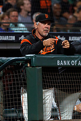 SAN FRANCISCO, CA - AUGUST 13: Bruce Bochy #15 of the San Francisco Giants signals from the dugout during the eighth inning against the Oakland Athletics at Oracle Park on August 13, 2019 in San Francisco, California. The San Francisco Giants defeated the Oakland Athletics 3-2. (Photo by Jason O. Watson/Getty Images) *** Local Caption *** Bruce Bochy