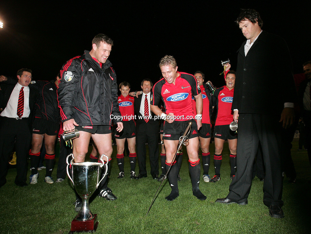 Departing Crusaders (L-R) Dave Hewett, Justin Marshall and Norm Maxwell put the Crusaders' sword into the middle of the pitch after the Rebel Sport Super 12 final match between the Crusaders and the Waratahs at Jade Stadium, Christchurch, New Zealand on Saturday 28 May, 2005. The Crusaders won the final 35 - 25. Photo: Hannah Johnston/PHOTOSPORT