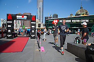 Luke Bell (AUS) and Dirk Bockel (GER), March 19, 2014 - Ironman Triathlon : Luke Bell (AUS) and Dirk Bockel (GER) demonstrate the instant triathlon. Tougher Than An IRONMAN, Federation Square, Melbourne, Victoria, Australia. Credit: Lucas Wroe