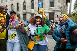 © Licensed to London News Pictures. 27/04/2019. London, UK. Supporters of African National Congress (ANC) singing outside High Commission of South Africa in London after casting their vote in this year's general election. Over 9000 South Africans have registered to vote in the UK, which is the highest number of registered voters living abroad. The Electoral Commission has extended voting hours for South African citizens in London until 11:30 pm on Saturday night because of the Vaisakhi Festival at Trafalgar square. Photo credit: Dinendra Haria/LNP