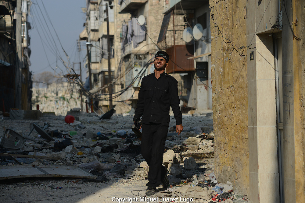 Aleppo, Syria, January 2013 - A Free Syrian Army rebel laughs after chasing off a Syrian Army sniper posted on the right side of the street along the border between Aleppo's Old City and the neighborhood of Hanano. (Photo Miguel Juárez Lugo)