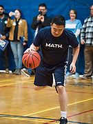12 DECEMBER 2019 - DES MOINES, IOWA: ANDREW YANG dribbles the ball during a basketball game with J.D. Scholten in the gym in the Ames, IA, City Hall. Scholten is an Iowa Democrat running against Republican Congressman Steve King. Yang, an entrepreneur, is running for the Democratic nomination for the US Presidency in 2020. He brought bus tour to Ames, IA, Thursday. Iowa hosts the the first election event of the presidential election cycle. The Iowa Caucuses will be on Feb. 3, 2020.        PHOTO BY JACK KURTZ