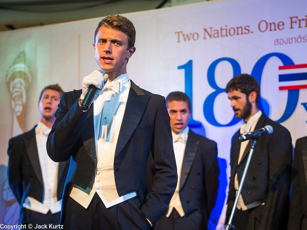 "19 JULY 2013 - BANGKOK, THAILAND:  HENRY GOTTFRIED, a  Yale senior theater studies major, fronts the Whiffenpoofs during their show in Bangkok Friday. The Yale Whiffenpoofs, one of the best-known collegiate a cappella groups in the world performed in CentralWorld in Bangkok Friday. Founded in 1909, the ""Whiffs"" began as a senior quartet that met for weekly concerts at Mory's Temple Bar, the famous Yale tavern. The Bangkok stop was a part of their 2013 world tour and was sponsored by the US Embassy. They sang at the opening of a photo exhibit that marked 180 years of friendly diplomatic relations between Thailand and the United States.    PHOTO BY JACK KURTZ"