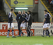 Dundee physio Gerry Doherty leads Dundee&rsquo;s Kevin Holt off the field after his head was cut by Aberdeen&rsquo;s Shaleum Logan's high boot - Aberdeen v Dundee, Ladbrokes Premiership at Pittodrie<br /> <br />  - &copy; David Young - www.davidyoungphoto.co.uk - email: davidyoungphoto@gmail.com