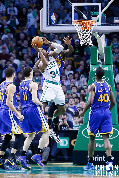 01 March 2013: Boston Celtics small forward Paul Pierce (34) goes to the basket against Golden State Warriors center Festus Ezeli (31) during the Boston Celtics 94-86 victory over the Golden State Warriors at the TD Garden, Boston, Massachusetts, USA.