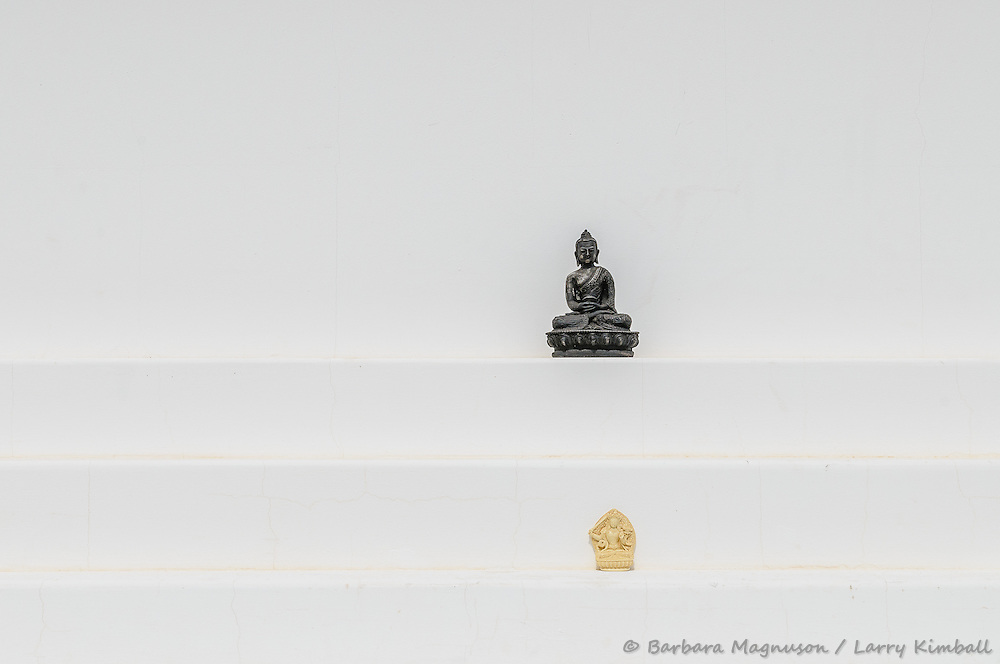Buddha statues adorn steps of Stupa monument; Crestone, CO