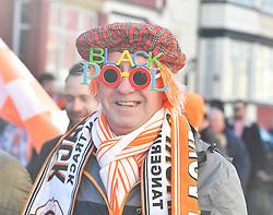 A Blackpool fan in party mood