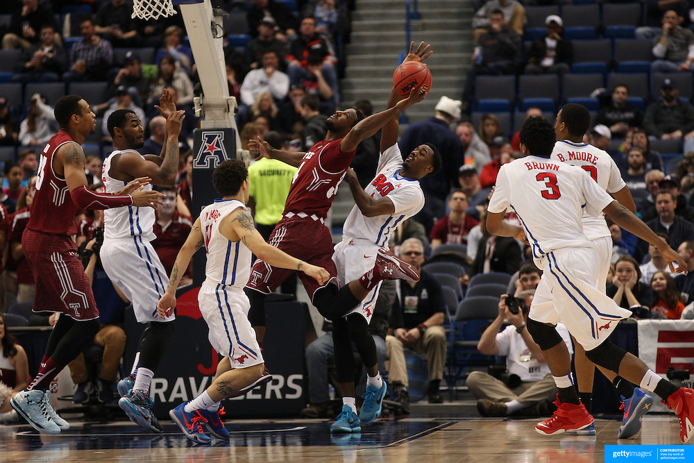 Devin Coleman, Temple, is blocked by Ryan Manuel, SMU, during the Temple Vs SMU Semi Final game at the American Athletic Conference Men's College Basketball Championships 2015 at the XL Center, Hartford, Connecticut, USA. 14th March 2015. Photo Tim Clayton