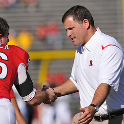 Sep 19, 2009; Piscataway, NJ, USA;  Rutgers head coach Greg Schiano shakes hands with Rutgers wide receiver Andrew DePaola (16) during warmups before the first half of NCAA college football between Rutgers and Florida International at Rutgers Stadium.