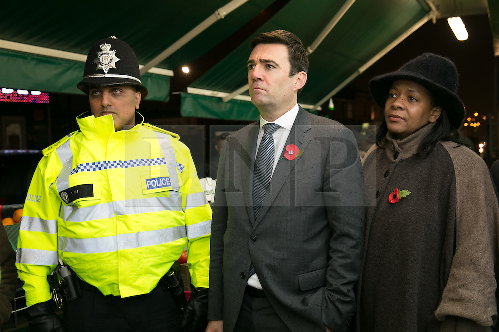 © Licensed to London News Pictures. 03/11/2015. Alum Rock, Birmingham, UK. Shadow Home Secretary ANDY BURNHAM visiting Alum Rock in Birmingham to launch the Labour Policy on Policing. Pictured, ANDY BURNHAM, centre, talking to Sgt IFTI ALI, left and Deputy Crime commissioner for West Midlands YVONNE MOSQUITO, right on the Alum Rock Road. Photo credit : Dave Warren/LNP