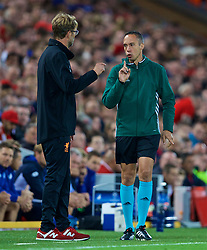LIVERPOOL, ENGLAND - Wednesday, August 23, 2017: Liverpool's manager Jürgen Klopp is told off by fourth official Andrea Crispo during the UEFA Champions League Play-Off 2nd Leg match between Liverpool and TSG 1899 Hoffenheim at Anfield. (Pic by David Rawcliffe/Propaganda)