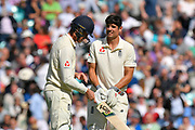 Alastair Cook of England and Keaton Jennings of England during the drinks break during the 5th International Test Match 2018 match between England and India at the Oval, London, United Kingdom on 7 September 2018.