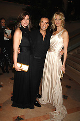 Left to right, NATALIE MASSENET Founder of Net-a-porter.com, JULIEN MACDONALD and MELISSA ODABASH at The Diner Des Tsars in aid of Unicef to celebrate the launch of Quintessentially Wine held at the Guildhall, London EC2 on 29th March 2007.<br />