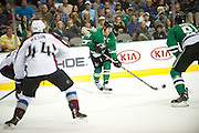 DALLAS, TX - NOVEMBER 1:  Jamie Benn #14 of the Dallas Stars controls the puck against the Colorado Avalanche on November 1, 2013 at the American Airlines Center in Dallas, Texas.  (Photo by Cooper Neill/Getty Images) *** Local Caption *** Jamie Benn