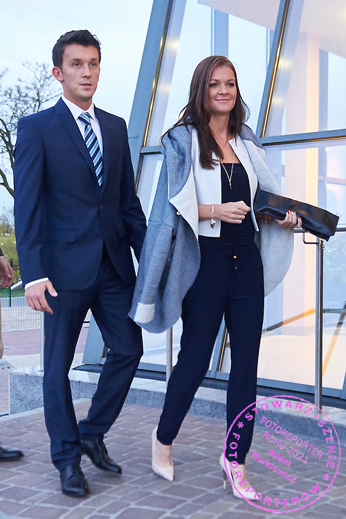 (L) Trainer assistant Dawid Celt and (R) Agnieszka Radwanska of Poland during official dinner on two days before the Fed Cup / World Group Play Off tennis match between Poland and Switzerland at The Zielona Gora Palm House on April 16, 2015 in Zielona Gora, Poland<br /> Poland, Zielona Gora, April 16, 2015<br /> <br /> Picture also available in RAW (NEF) or TIFF format on special request.<br /> <br /> For editorial use only. Any commercial or promotional use requires permission.<br /> <br /> Adam Nurkiewicz declares that he has no rights to the image of people at the photographs of his authorship.<br /> <br /> Mandatory credit:<br /> Photo by &copy; Adam Nurkiewicz / Mediasport
