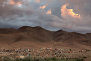 TALIOUINE, MOROCCO - October 24th 2015 - Dramatic, cloudy sunset over Taliouine, Sirwa Mountain Range, Souss Massa Draa region of Southern Morocco