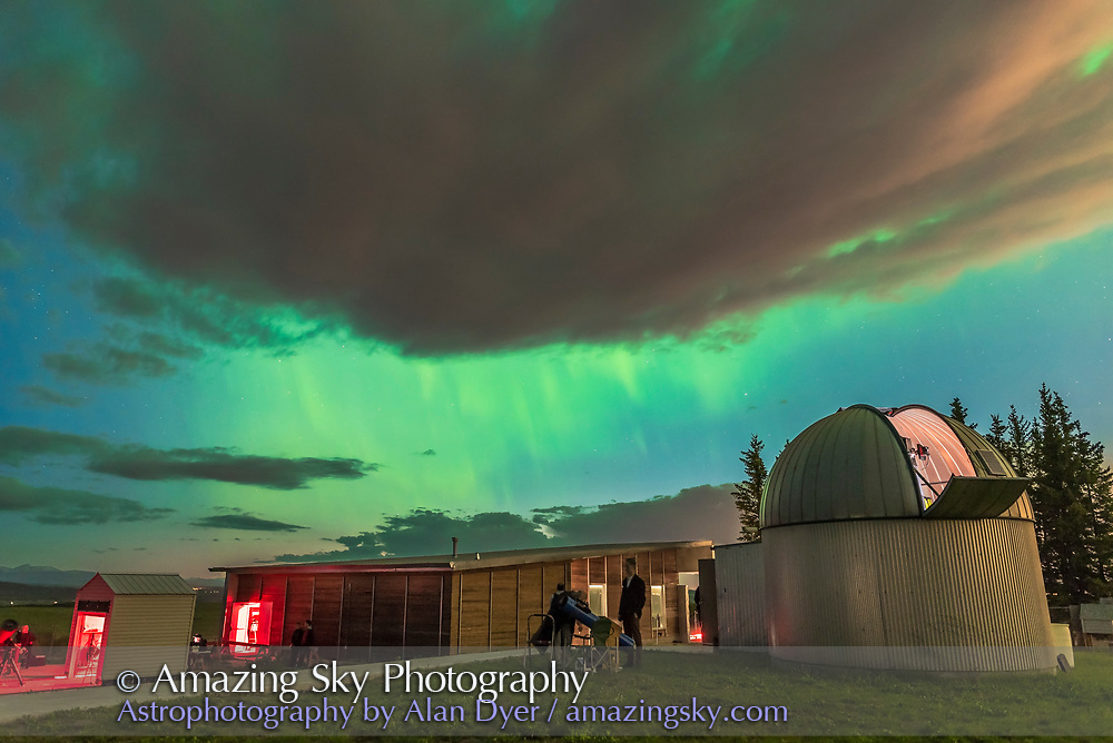 The great aurora display of May 27, 2017 over the Rothney Astrohysical Observatory, near Calgary, Alberta. Taken at the Open House toward the end of the evening. The clouds are lit by light pollution from Calgary.